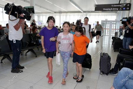 (L-R) Elizabeth Taylor (10), Isla Dawson (8) and Isabel Taylor (9) are seen arriving from Christmas Island at Perth Airport in Perth, Australia, 17 February 2020. More than 200 Australians are due to fly home from Christmas Island after being quarantined in the former detention centre because of the coronavirus.