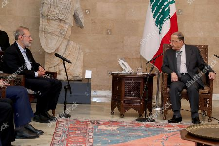 Ali Larijani, Michel Aoun. In this photo released by the Lebanese Government, Iran's Parliament Speaker Ali Larijani, left, meets with Lebanese President Michel Aoun, at the Presidential Palace in Baabda, east of Beirut, Lebanon