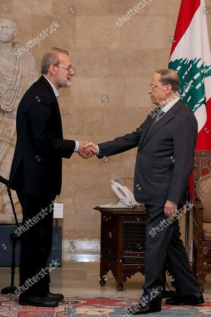 Ali Larijani, Michel Aoun. In this photo released by the Lebanese Government, Iran's Parliament Speaker Ali Larijani, left, shakes hands with Lebanese President Michel Aoun, at the Presidential Palace in Baabda, east of Beirut, Lebanon