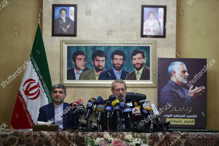 Ali Larijani, Mohammed Jalal Feiruznia. Iran's Parliament Speaker Ali Larijani, center, speaks during a press conference next to Iran's Ambassador to Lebanon Mohammed Jalal Feiruznia, in front of a painting of four missing Iranian diplomats who disappeared during the 1982 Israeli invasion of Lebanon, at the Iranian Embassy in Beirut, Lebanon