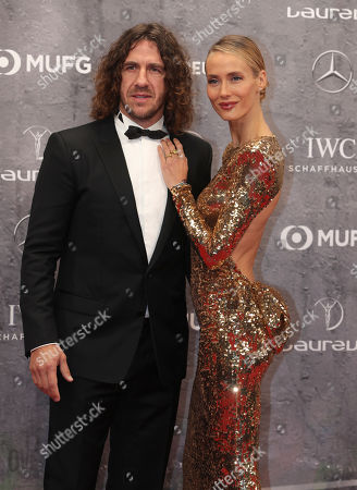 Former Spanish soccer player Carles Puyol and his partner Vanessa Lorenzo arrive for the 2020 Laureus World Sports Awards in Berlin, Germany