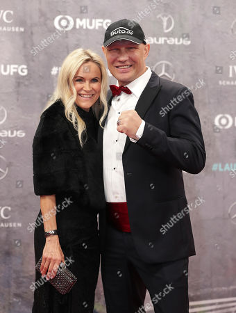 Axel Schulz, a German former professional boxer and his wife Patricia arrive for the 2020 Laureus World Sports Awards in Berlin, Germany