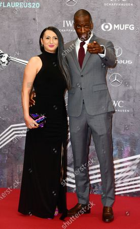 Former 200m and 400m World Record holder Michael Johnson and wife Armine Shamiryan arrive for the Laureus World Sports Awards ceremony at the Verti Music Hall in Berlin, Germany, 17 February 2020.