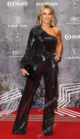 Stock Photo of Former Romanian gymnast and five-time olympic gold medalist Nadia Comaneci arrives for the Laureus World Sports Awards ceremony at the Verti Music Hall in Berlin, Germany, 17 February 2020.