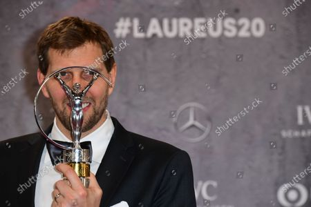 German basketball player Dirk Nowitzki poses with his lifetime achievement award at the Laureus World Sports Awards ceremony at the Verti Music Hall in Berlin, Germany, 17 February 2020.