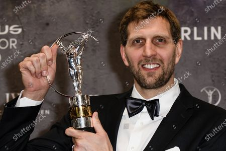 Former NBA basketball player Dirk Nowitzki of Germany poses with his lifetime achievement award at the Laureus World Sports Awards ceremony at the Verti Music Hall in Berlin, Germany, 17 February 2020.