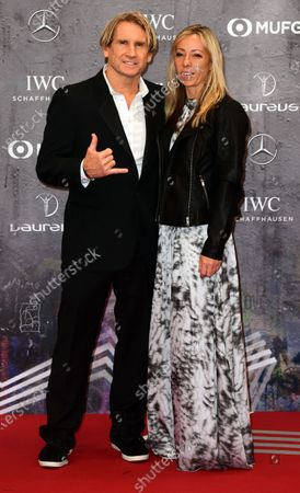 US surfing legend Robby Naish and wife Katie Naish arrive for the Laureus World Sports Awards ceremony at the Verti Music Hall in Berlin, Germany, 17 February 2020.