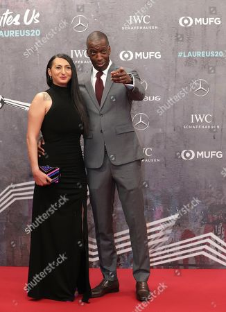Former track star Michael Johnson and his wife Kerry Doyen arrive for the 2020 Laureus World Sports Awards in Berlin, Germany