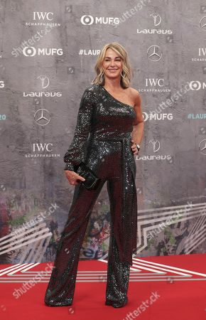 Gymnastics legend Nadia Comaneci smiles as she arrives for the 2020 Laureus World Sports Awards in Berlin, Germany