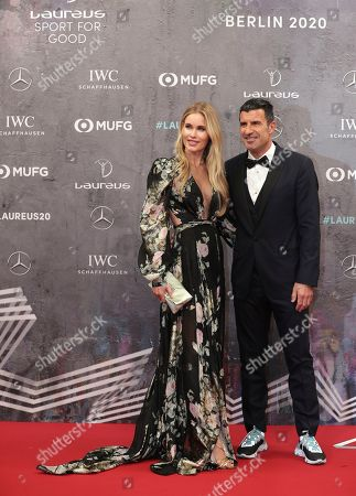 Former Portuguese soccer player Luis Figo and his wife Helen Svedin arrive for the 2020 Laureus World Sports Awards in Berlin, Germany
