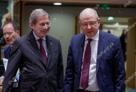 EU Commissioner for Enlargement Negotiations, Johannes Hahn (L) and Belgian Minister of Justice Koen Geens attend a European General affairs council in Brussels, Belgium, 17 February 2020.
