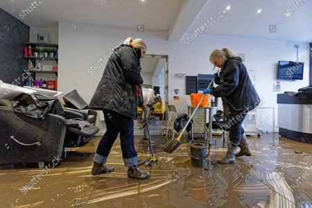 (L-R) Laura Court and Louise Bedgood mop up the floor of Lougos hair dressers in Oxford Street, Nantgarw, Wales, Britain, 17 February 2020. Storm Dennis hit the region over the past weekend bringing torrential rains, floods and landslides.