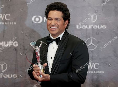 Sachin Tendulkar poses with the 'Best Sporting Moment Award' during the 2020 Laureus World Sports Awards in Berlin, Germany