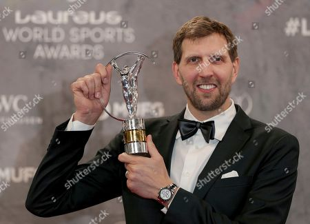 Dirk Nowitzki poses with the 'Lifetime Achievement Award' during the 2020 Laureus World Sports Awards in Berlin, Germany