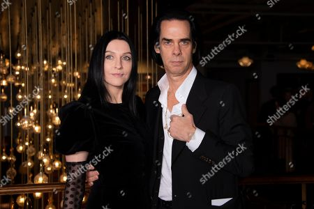 Stock Photo of Nick Cave, Susie Bick. Musician Nick Cave, right, and fashion designer wife Susie Bick pose for photographers during a UK charity premiere for the film 'True History of the Kelly Gang' at a central London cinema