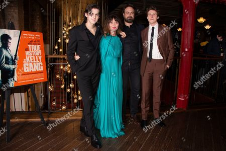 Stock Image of George Mackay, Essie Davis, Earl Cave, Justin Kurzel. Actors Earl Cave, Essie Davis, Director Justin Kurzel, and George Mackay pose for photographers during a UK charity premiere for the film 'True History of the Kelly Gang' at a central London cinema