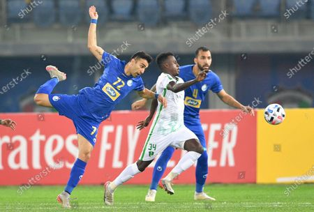 Stock Picture of Mazen Abu Sharah (C) of Al Ahli FC in action against Amir Arsalan Motahari (L) of Esteghlal FC during the AFC Champions League group stage soccer match between Al Ahli FC and Esteghlal FC in Kuwait City, Kuwait, 17 February 2020.