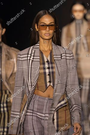 Joan Smalls wears a creation by designer Burberry at the Autumn/Winter 2020 fashion week runway show in London