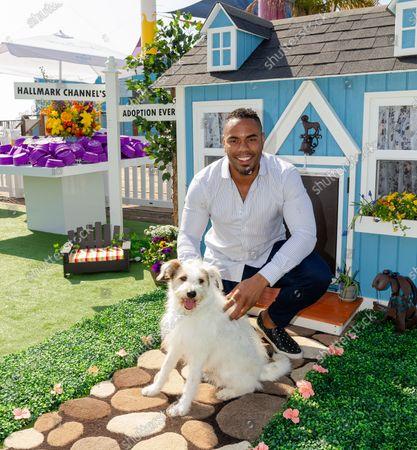 Rashad Jennings and Happy the Dog
