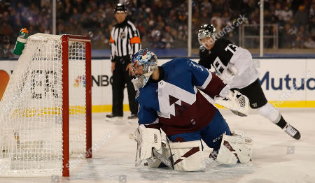 R m. Colorado Avalanche goaltender Philipp Grubauer (31) checks the net after a shot off the stick of Los Angeles Kings right wing Tyler Toffoli (73) in the first period of an NHL hockey game, at Air Force Academy, Colo