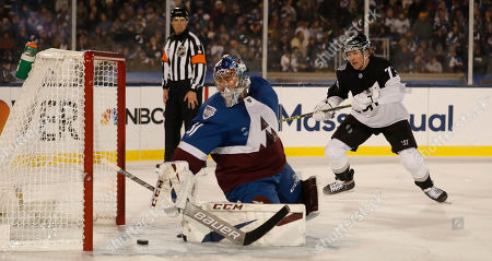Stock Photo of R m. Colorado Avalanche goaltender Philipp Grubauer (31) misses a shot off the stick of Los Angeles Kings right wing Tyler Toffoli (73) in the first period of an NHL hockey game, at Air Force Academy, Colo