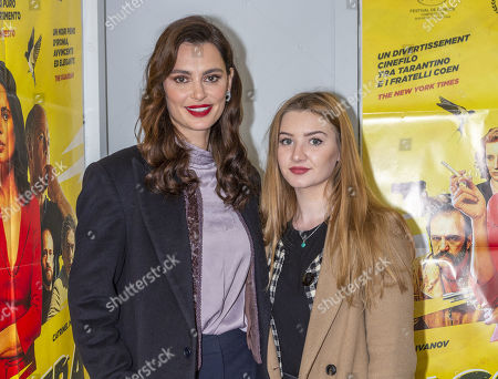 Stock Picture of Catrinel Menghia and guest