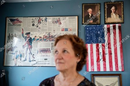 "American Revolutionary War paraphernalia decorates the home of Janet Uhlar, one of 12 jurors who convicted Boston organized crime boss James ""Whitey"" Bulger, in Eastham, Mass. ""The foundational pillars of the nation, what they built the nation upon, it's all corrupted and collapsing. I think we need to admit we did this,"" said Uhlar. ""How many people did they do this to? How many came out like Bulger"