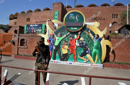 A police officer stands guard next to poster of cricket players displayed outside the Gaddafi stadium for upcoming Pakistan Super League, in Lahore, Pakistan. Security concerns stopped foreign cricketers from touring Pakistan four years ago when the country's premier domestic Twenty20 tournament was launched, forcing organizers to stage the event on neutral turf in the United Arab Emirates. When the 2020 edition of the PSL starts in Karachi on Thursday, Darren Sammy of the West Indies and Shane Watson of Australia will be among 36 foreign cricketers involved in the six franchises