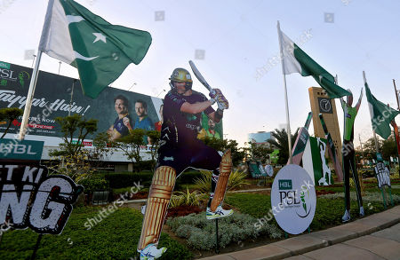 A cut-out of a cricketer Shane Watson of Australia, displays along roadside in preparation of the upcoming Pakistan Super League, in Karachi, Pakistan. Security concerns stopped foreign cricketers from touring Pakistan four years ago when the country's premier domestic Twenty20 tournament was launched, forcing organizers to stage the event on neutral turf in the United Arab Emirates. When the 2020 edition of the PSL starts in Karachi on Thursday, Darren Sammy of the West Indies and Shane Watson of Australia will be among 36 foreign cricketers involved in the six franchises