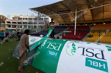 Workers decorate an enclosure at National stadium in preparation for upcoming Pakistan Super League, in Karachi, Pakistan. Security concerns stopped foreign cricketers from touring Pakistan four years ago when the country's premier domestic Twenty20 tournament was launched, forcing organizers to stage the event on neutral turf in the United Arab Emirates. When the 2020 edition of the PSL starts in Karachi on Thursday, Darren Sammy of the West Indies and Shane Watson of Australia will be among 36 foreign cricketers involved in the six franchises
