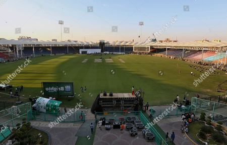 Workers prepare stage for opening ceremony of Pakistan Super League at National stadium in Karachi, Pakistan. Security concerns stopped foreign cricketers from touring Pakistan four years ago when the country's premier domestic Twenty20 tournament was launched, forcing organizers to stage the event on neutral turf in the United Arab Emirates. When the 2020 edition of the PSL starts in Karachi on Thursday, Darren Sammy of the West Indies and Shane Watson of Australia will be among 36 foreign cricketers involved in the six franchises