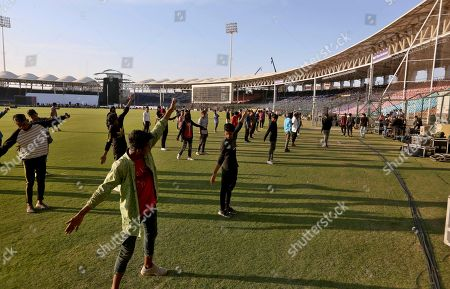 Performers participate in rehearsal for opening ceremony of Pakistan Super League at National stadium in Karachi, Pakistan. Security concerns stopped foreign cricketers from touring Pakistan four years ago when the country's premier domestic Twenty20 tournament was launched, forcing organizers to stage the event on neutral turf in the United Arab Emirates. When the 2020 edition of the PSL starts in Karachi on Thursday, Darren Sammy of the West Indies and Shane Watson of Australia will be among 36 foreign cricketers involved in the six franchises