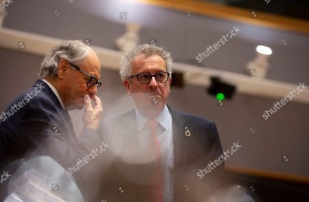 Luxembourg's Finance Minister Pierre Gramegna, right, speaks with Malta's Finance Minister Edward Scicluna during a meeting of EU finance ministers at the Europa building in Brussels, . EU finance ministers meet Tuesday to discuss tax havens