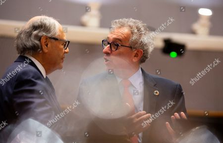 Stock Image of Luxembourg's Finance Minister Pierre Gramegna, right, speaks with Malta's Finance Minister Edward Scicluna during a meeting of EU finance ministers at the Europa building in Brussels, . EU finance ministers meet Tuesday to discuss tax havens