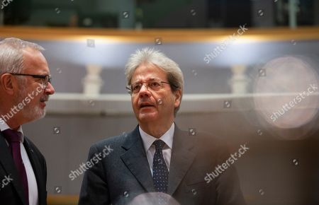 European Commissioner for Economy Paolo Gentiloni, right, speaks with President of the European Investment Bank Werner Hoyer during a meeting of EU finance ministers at the Europa building in Brussels, . EU finance ministers meet Tuesday to discuss tax havens