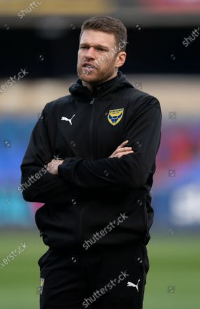 Jamie Mackie of Oxford United inspects the pitch before the match
