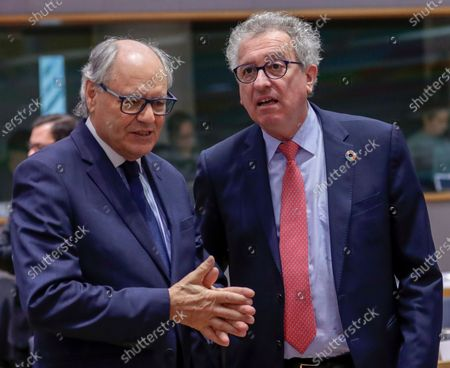 Malta's Finance Minister Edward Scicluna (L) and Luxembourg's Finance Minister Pierre Gramegna attend an Economic and Financial Affairs Council (ECOFIN) Finance Ministers' meeting in Brussels, Belgium, 18 February 2020.