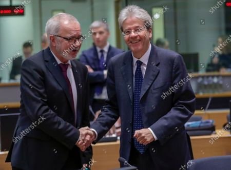 Stock Photo of European Investment Bank (EIB) President Werner Hoyer and European Commissioner for Economy Paolo Gentiloni (R) attend an Economic and Financial Affairs Council (ECOFIN) Finance Ministers' meeting in Brussels, Belgium, 18 February 2020.