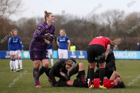 Jess Sigsworth of Manchester United Women FC is treated for a knock
