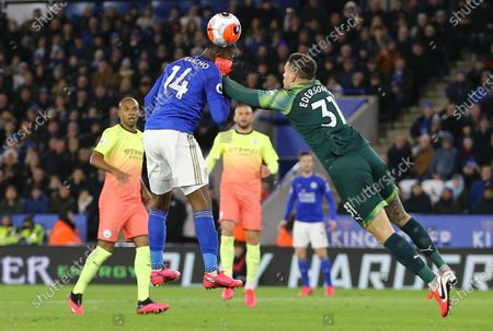 Ederson Moraes of Manchester City appears to punch Kelechi Iheanacho of Leicester City in his head