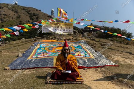 Ngawang Kunga Tenzin Gyatso Rinpoche prays during a Buddha Sunning Festival in Tai Mo Shan, Hong Kong, China, 18 February 2020. Rinpoche led a prayer and offered blessings to Hong Kong as the city deals with the novel coronavirus that causes the disease known as Covid-19. As of 18 February a total of 61 people were infected in Hong Kong, while in mainland China the number of cases leapt to more than 72,000 and the death toll was at least 1,860.