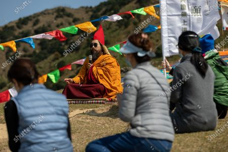 Worshippers and Ngawang Kunga Tenzin Gyatso Rinpoche, (C), pray during a Buddha Sunning Festival on Tai Mo Shan, Hong Kong, China, 18 February 2020. Rinpoche led a prayer and offered blessings to Hong Kong as the city deals with the novel coronavirus that causes the disease known as Covid-19. As of 18 February a total of 61 people were infected in Hong Kong, while in mainland China the number of cases leapt to more than 72,000 and the death toll was at least 1,860.