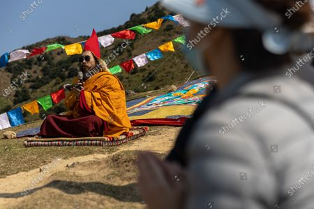 Ngawang Kunga Tenzin Gyatso Rinpoche (L) prays during a Buddha Sunning Festival in Tai Mo Shan, Hong Kong, China, 18 February 2020. Rinpoche led a prayer and offered blessings to Hong Kong as the city deals with the novel coronavirus that causes the disease known as Covid-19. As of 18 February a total of 61 people were infected in Hong Kong, while in mainland China the number of cases leapt to more than 72,000 and the death toll was at least 1,860.