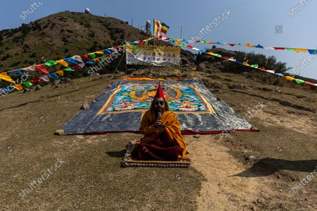 Stock Picture of Ngawang Kunga Tenzin Gyatso Rinpoche prays during a Buddha Sunning Festival in Tai Mo Shan, Hong Kong, China, 18 February 2020. Rinpoche led a prayer and offered blessings to Hong Kong as the city deals with the novel coronavirus that causes the disease known as Covid-19. As of 18 February a total of 61 people were infected in Hong Kong, while in mainland China the number of cases leapt to more than 72,000 and the death toll was at least 1,860.