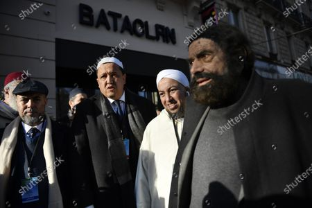 Imam Hassen Chalghoumi (C-L) and French author Marek Halter (R) gather with a group of Imams from Europe in front of the entrance the Bataclan concert venue and pay their respects during a tribute for victims of the November 2015 Paris attacks, in which 130 people were killed, in Paris, France, 18 February 2020.