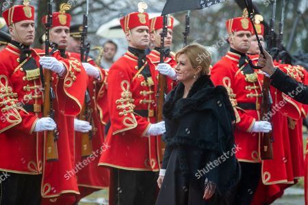 Stock Photo of Outgoing Croatian President Kolinda Grabar Kitarovic walks past honor guards as she arrives for the oath taking ceremony of President elect Zoran Milanovic Zagreb, Croatia