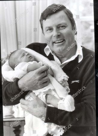 Editorial image of Peter Alliss - Golfer 6th March 1983 Peter Alliss With 9 Day Old Baby Son At Their Hindhead Surrey Home....golfer