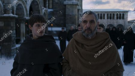 Stock Image of Damian Hardung as Adso and John Turturro as William of Baskerville