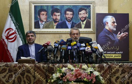 Iran's Speaker of Parliament Ali Larijani (R) addresses a press conference at the Iranian embassy in Lebanon