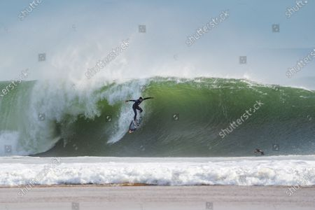 Stock Photo of The Brazilian Surfer, Pedro Scooby rides on a wave